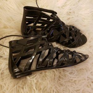 Black jelly gladiator sandals